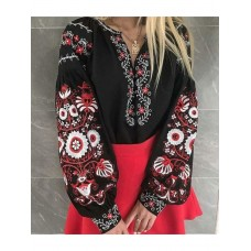 Beautiful and colorful women's embroidered blouse on a black homespun cloth