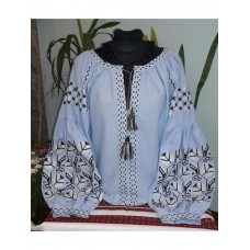 Beautiful embroidered shirt for women on a blue homespun cloth